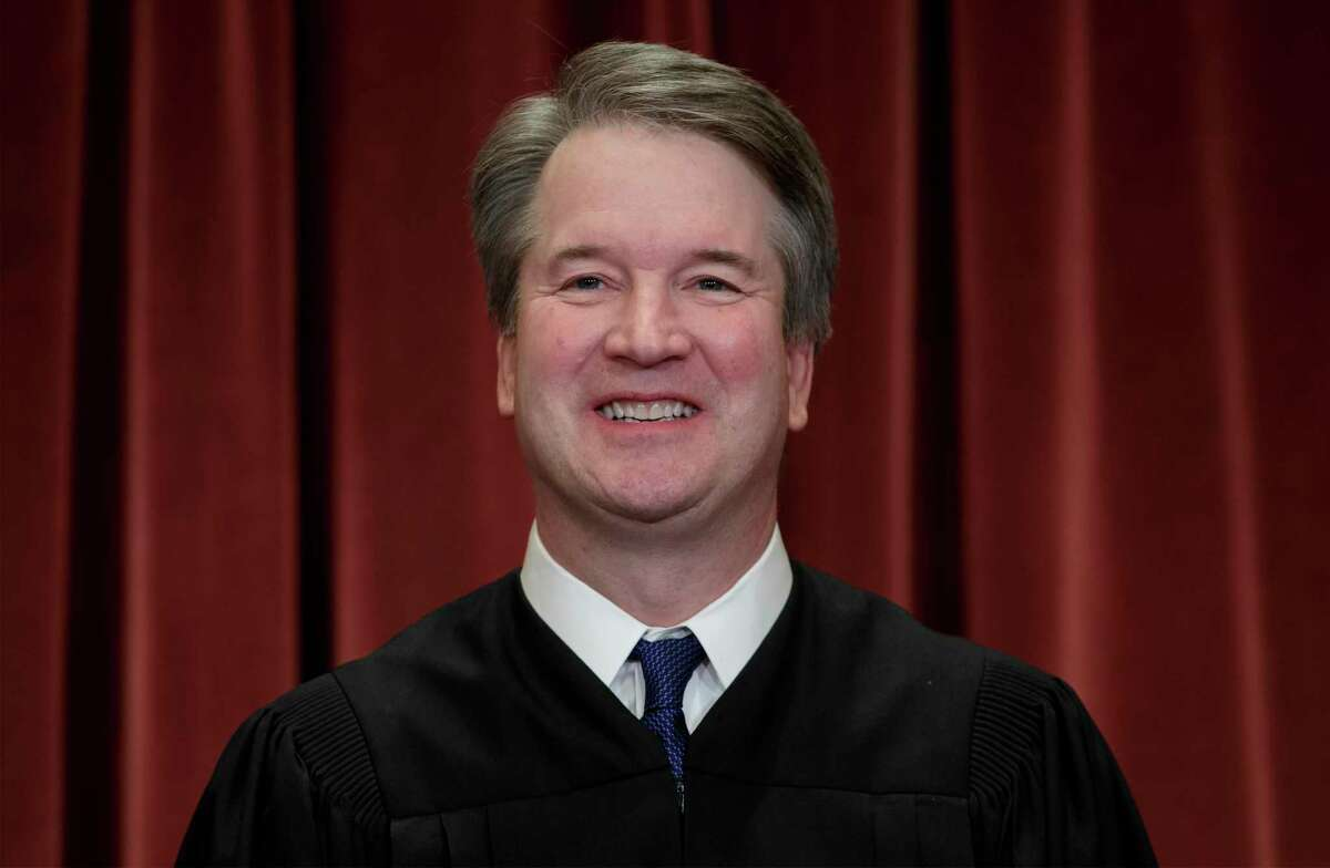FILE - In this Nov. 30, 2018, file photo Associate Justice Brett Kavanaugh sits with fellow Supreme Court justices for a group portrait at the Supreme Court Building in Washington. (AP Photo/J. Scott Applewhite, File)