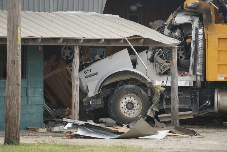 A dump truck driver died Tuesday Sept. 17, 2019, after his truck crashed through a business in the 4200 block of Frontage Road near Interstate 10 and North W.W. White Road. Photo: Jacob Beltran