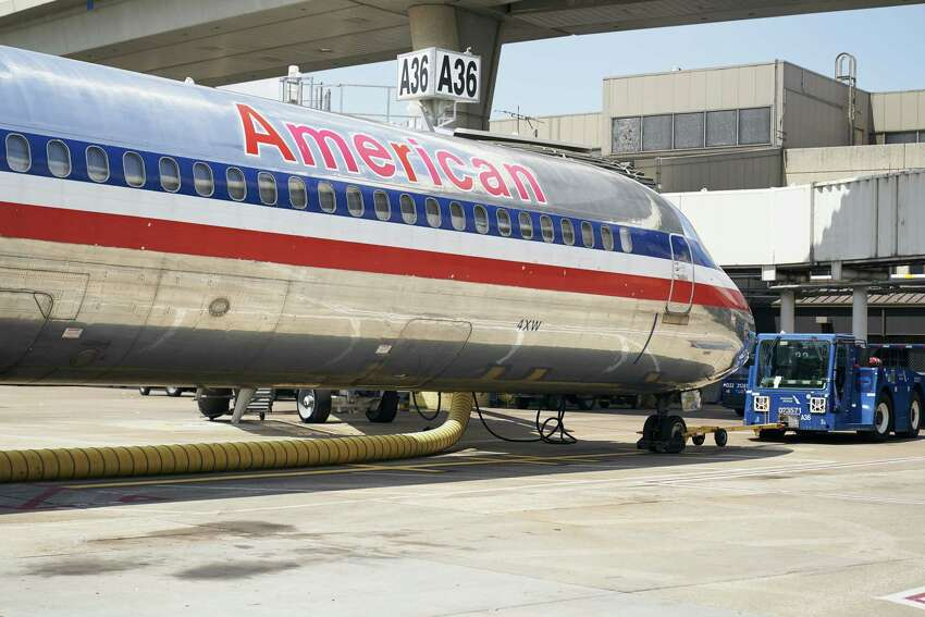 Signage is displayed on an American Airlines MD-80 aircraft at Dallas/Fort Worth International Airport (DFW) near Dallas, Texas, on Sunday, Sept. 1, 2019. On Wednesday, after 36 years, American will operate the last commercial trip of the MD-80, flying from Dallas to Chicago. Airlines now have moved on to models with better fuel efficiency, additional seats and the latest technology, including a more computerized cockpit. Photographer: Cooper Neill/Bloomberg