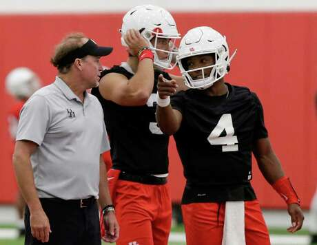 For the third consecutive week, UH coach Dana Holgorsen, left, and quarterbacks D'Eriq King (4) and Clayton Tune have had only six days to prepare for a game.