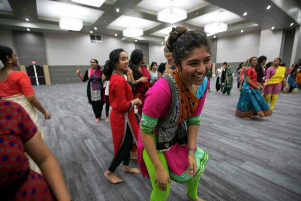 """Bhavana Gollapudi laughs during dance practice at Gujarati Samaj on Sunday, Sept. 15, 2019, in Houston. Several forms of classical Indian dance groups will join other styles of dance as part of a bigger performance entitled """"Woven"""" by artistic director Heena Patel."""