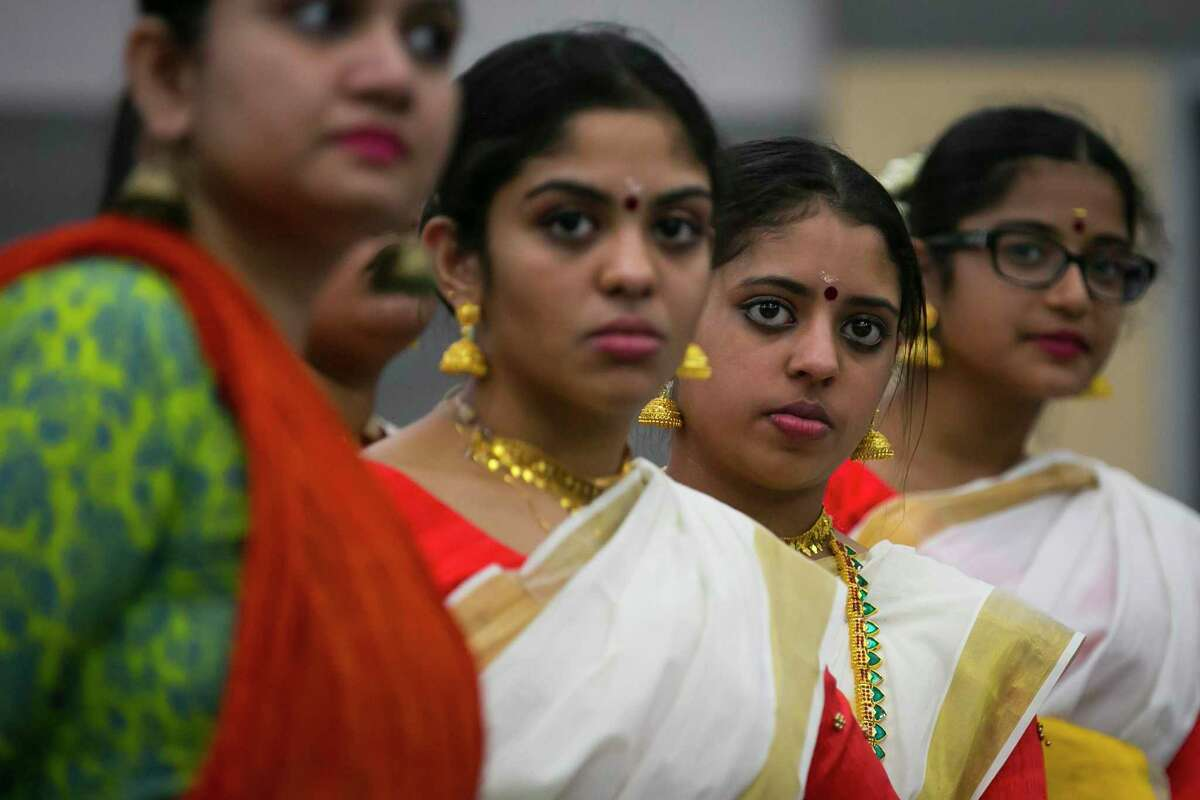 """Dancers line up to listen to instruction during dance practice at Gujarati Samaj on Sunday, Sept. 15, 2019, in Houston. Several forms of classical Indian dance groups will join other styles of dance as part of a bigger performance entitled """"Woven"""" by artistic director Heena Patel."""