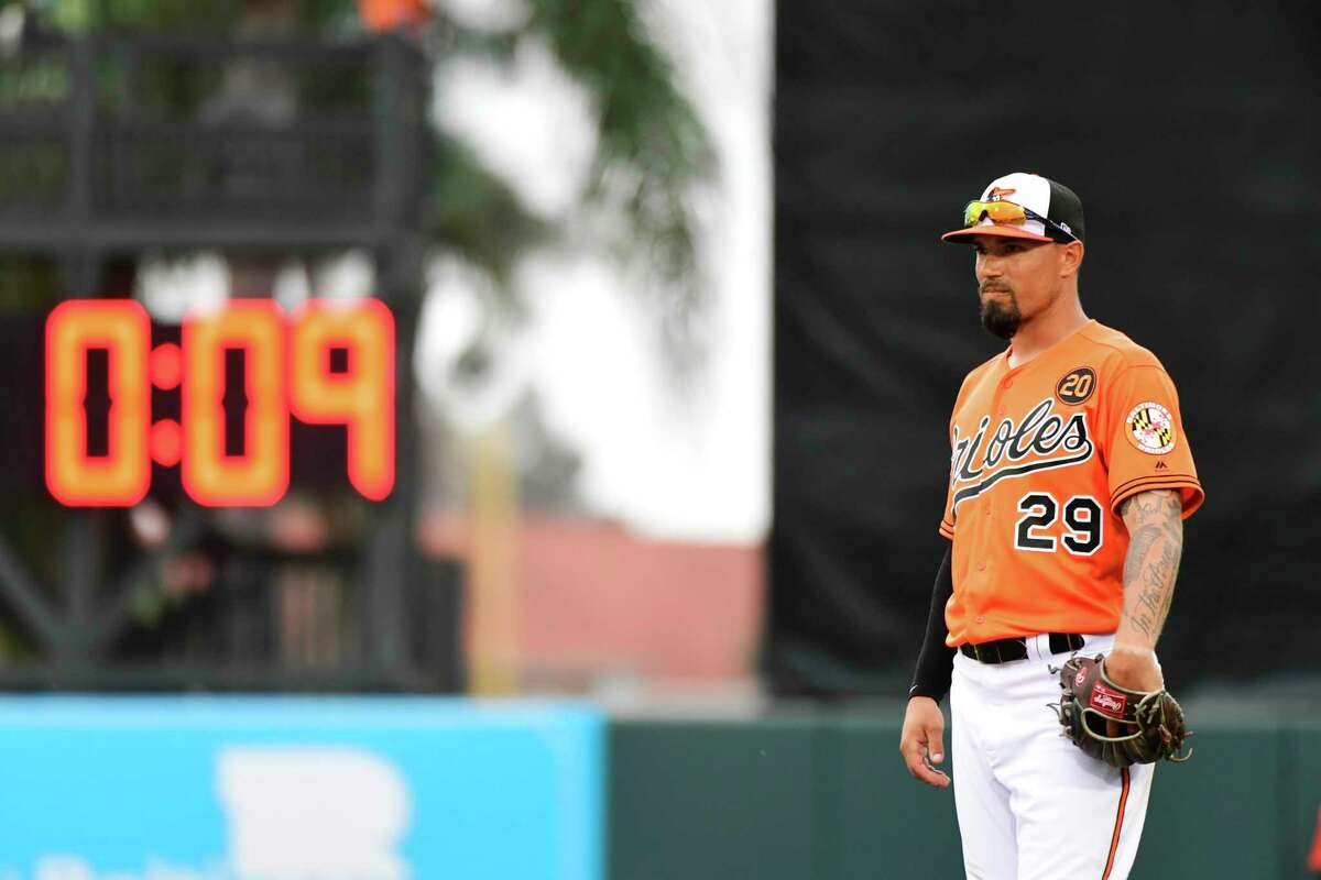 SARASOTA, FLORIDA - FEBRUARY 26: Jace Peterson #29 of the Baltimore Orioles stands in front of a pitch clock during the eighth inning of a baseball game against the Tampa Bay Rays at Ed Smith Stadium on February 26, 2019 in Sarasota, Florida. (Photo by Julio Aguilar/Getty Images)