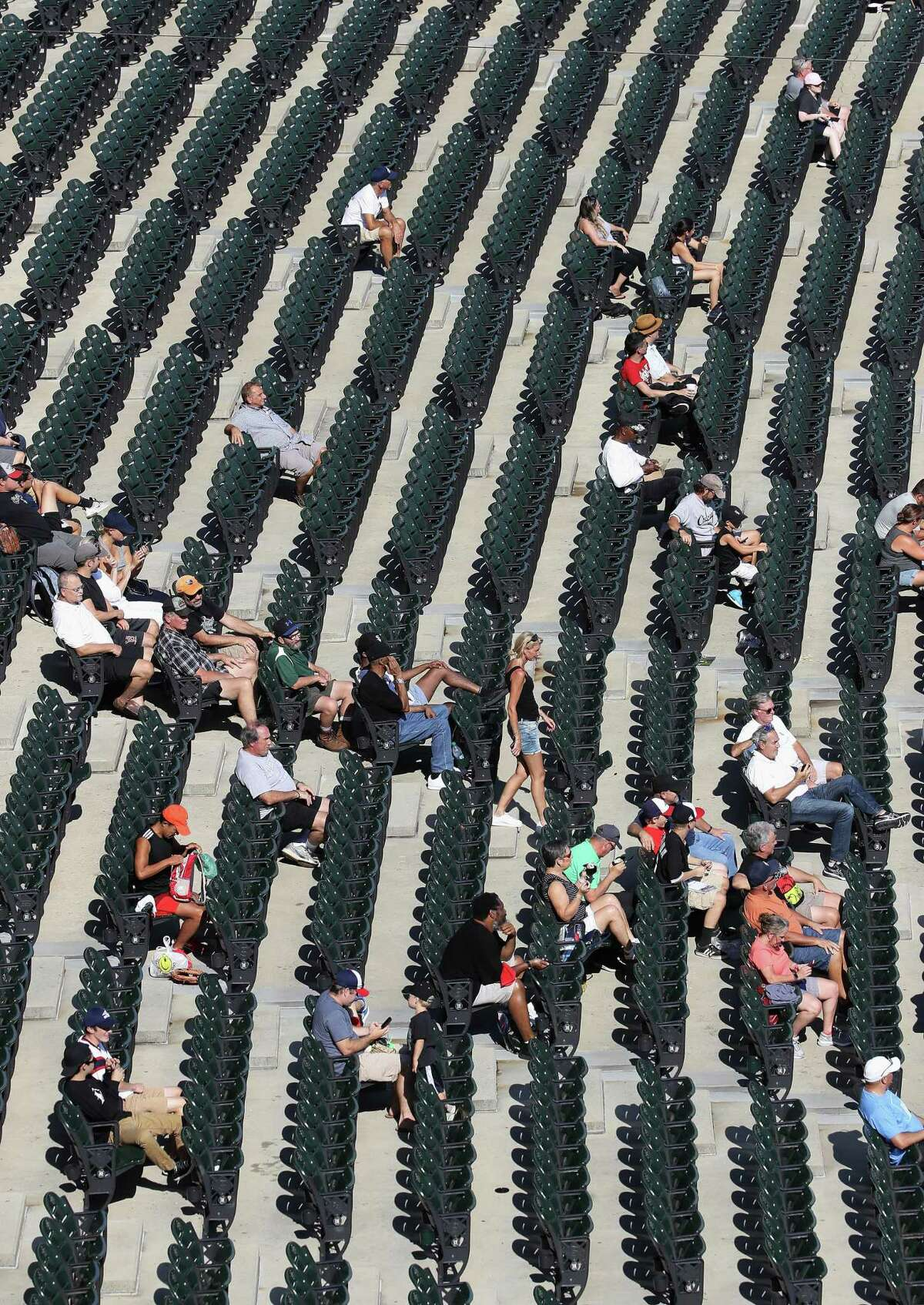 CHICAGO, ILLINOIS - AUGUST 13: A small crowd attends the first game of a double header at Guaranteed Rate Field between the Chicago White Sox and the Houston Astros on August 13, 2019 in Chicago, Illinois. (Photo by Jonathan Daniel/Getty Images)