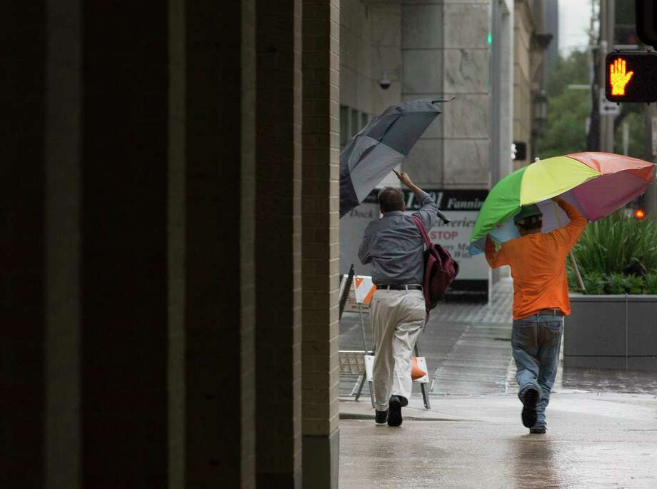Pedestrians hold on to their umbrellas while crossing Fanning and Polk Streets as Tropical Storm Imelda is making its way across the Houston area during rush hour on Tuesday, Sept. 17, 2019, in downtown Houston. Photo: Yi-Chin Lee, Houston Chronicle / © 2019 Houston Chronicle