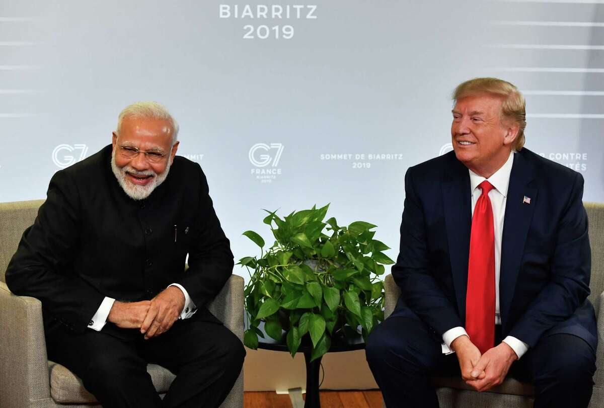 In this file photo taken on August 25, 2019 Indian Prime Minister Narendra Modi (L) and US President Donald Trump speak during a bilateral meeting in Biarritz, south-west France on the third day of the annual G7 Summit. Trump will join Modi at a massive gathering of Indian-Americans in Houston on September 15, 2019.