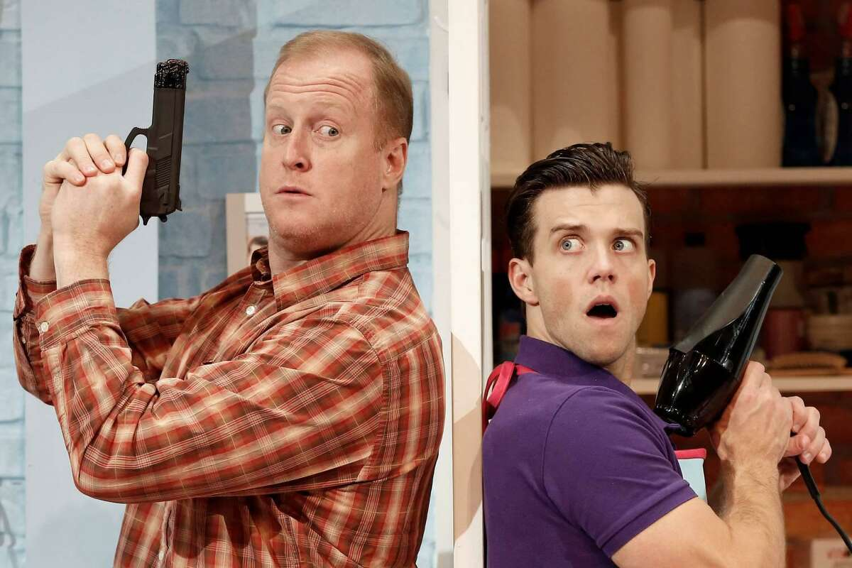 """Detective Nick O'Brien (Patrick Noonan) and salon owner Tony Whitcomb (Jordan Ahnquist) square off in """"Shear Madness"""" at the Ivoryton Playhouse."""