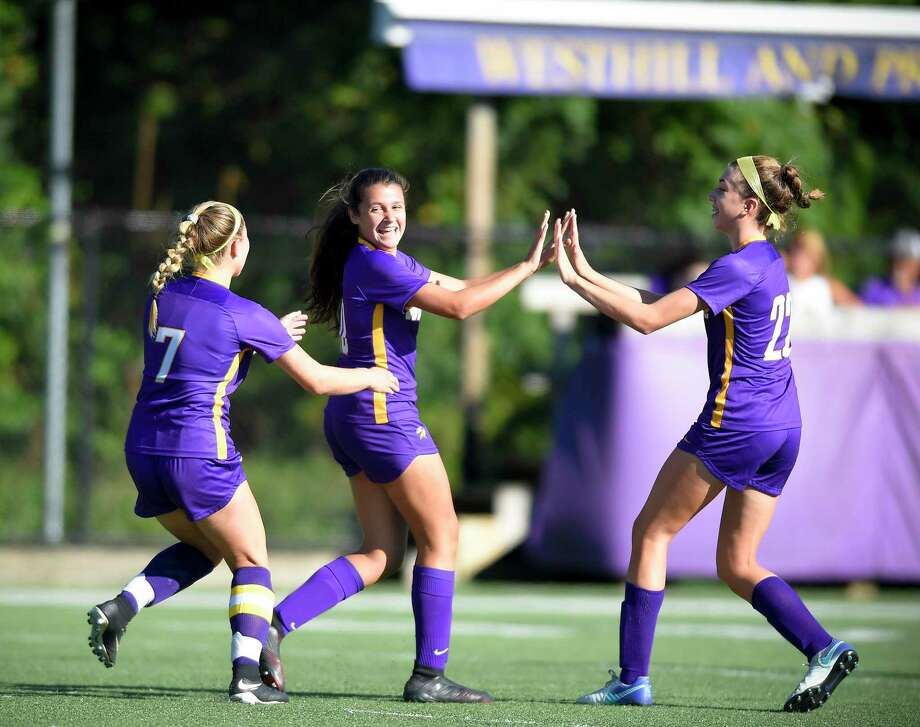 Westhill freshman Sofia Romero, center, celebrates her first-half goal against Bridgeport Central. Romero scored three goals on a 5-0 win on Tuesday in Stamford. Photo: Matthew Brown / Hearst Connecticut Media / Stamford Advocate