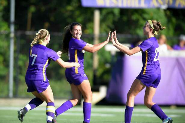 Westhill freshman Sofia Romero, center, celebrates her first-half goal against Bridgeport Central. Romero scored three goals on a 5-0 win on Tuesday in Stamford.