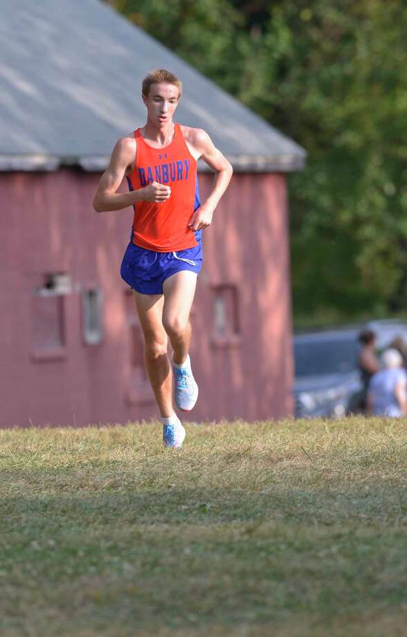 Danbury's Jack Watson finished first in the boys Cross Country meet between Fairfield Ludlowe, Greenwich, Norwalk and Danbury high schools, Wednesday, September 11, 2019, at Tarrywile Park, Danbury, Conn. Photo: H John Voorhees III / Hearst Connecticut Media / The News-Times