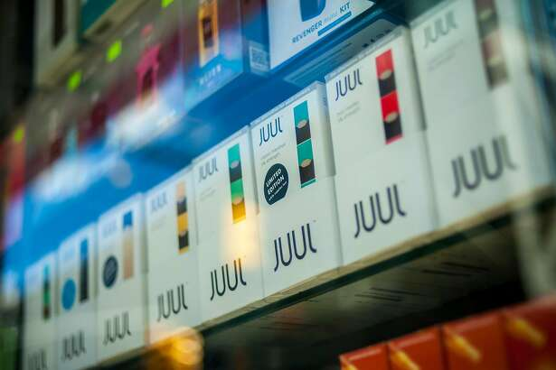 A selection of the popular Juul brand vaping supplies on display in the window of a vaping store in New York on Saturday, March 24, 2018. (Richard B. Levine/Sipa USA/TNS)