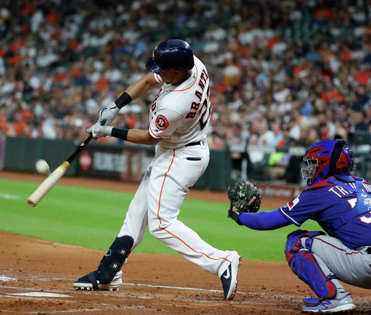 Houston Astros Michael Brantley (23) fouls off a ball during his at bat in the first inning of an MLB baseball game at Minute Maid Park, Tuesday, Sept. 17, 2019, in Houston.