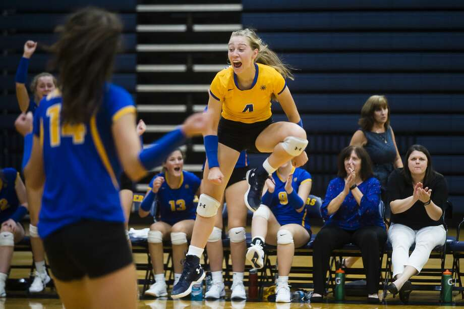 Midland's Gabby Schloop celebrates a point during a match against Mount Pleasant Tuesday, Sept. 17, 2019 at Mount Pleasant High School. (Katy Kildee/kkildee@mdn.net) Photo: (Katy Kildee/kkildee@mdn.net)