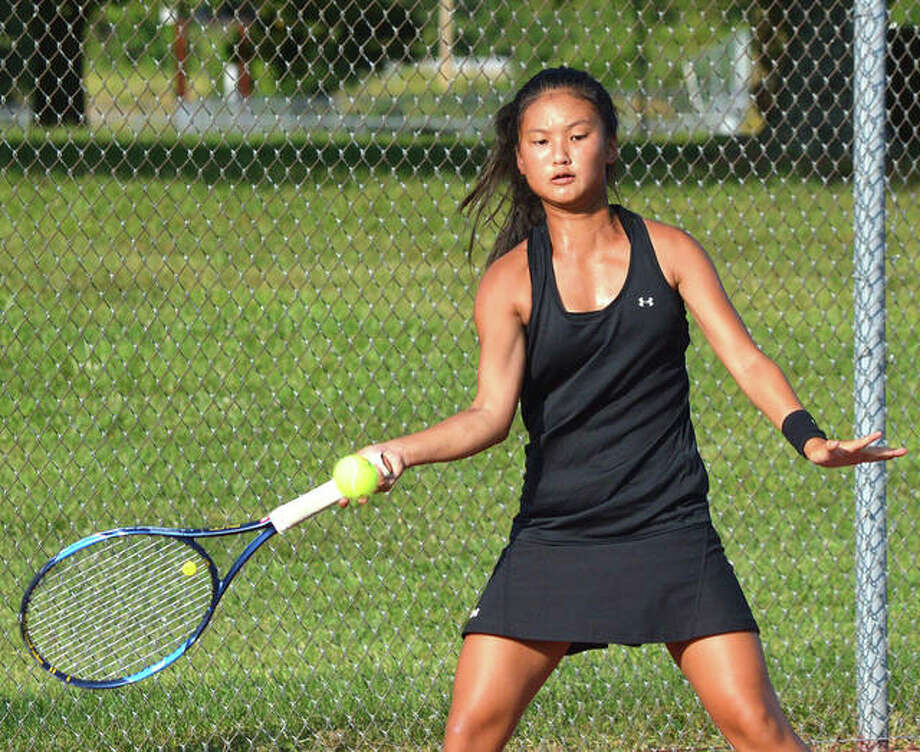 Edwardsville freshman Chloe Koons makes a forehand return during her No. 1 singles match against Belleville West's Kaitlin Fiedler on Tuesday at the EHS Tennis Center. Photo: Scott Marion/The Intelligencer