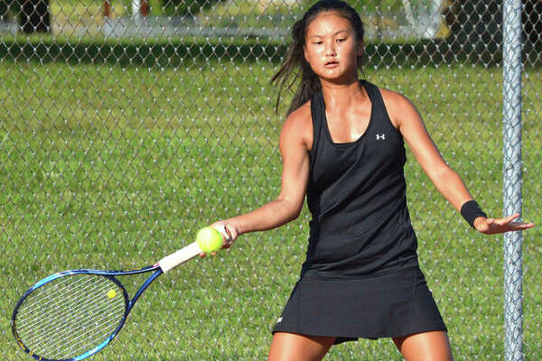 Edwardsville freshman Chloe Koons makes a forehand return during her No. 1 singles match against Belleville West's Kaitlin Fiedler on Tuesday at the EHS Tennis Center.
