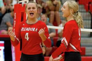 Splendora outside hitter Shaelyn Sanders (4) reacts after a point beside Katie Brzowski (9) during the first set of a non-district high school volleyball match at Splendora High School, Tuesday, Sept. 16, 2019, in Splendora.