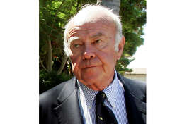 FILE - This Sept. 5, 2006 file photo shows journalist Sander Vanocur supporting Santa Barbara News-Press employees wishing to unionize during a news conference in Santa Barbara, Calif. Vanocur, a network news reporter who for decades covered the biggest moments in politics, died Monday, Sept. 16, 2019, in Santa Barbara, Calif. He was 91. (AP Photo/Reed Saxon, File)