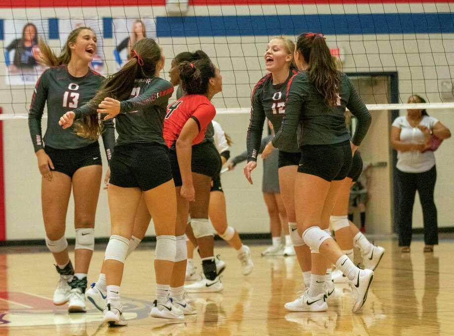Oak Ridge celebrates after scoring during a District 15-6A volleyball match at Oak Ridge High School in Oak Ridge North. Photo: Cody Bahn, Houston Chronicle / Staff Photographer / © 2019 Houston Chronicle