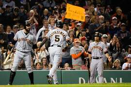 BOSTON, MA - SEPTEMBER 17: Mike Yastrzemski #5 celebrates with teammate Evan Longoria #10 of the San Francisco Giants after hitting a solo home run in the fourth inning against the Boston Red Sox at Fenway Park on September 17, 2019 in Boston, Massachusetts. (Photo by Kathryn Riley/Getty Images)