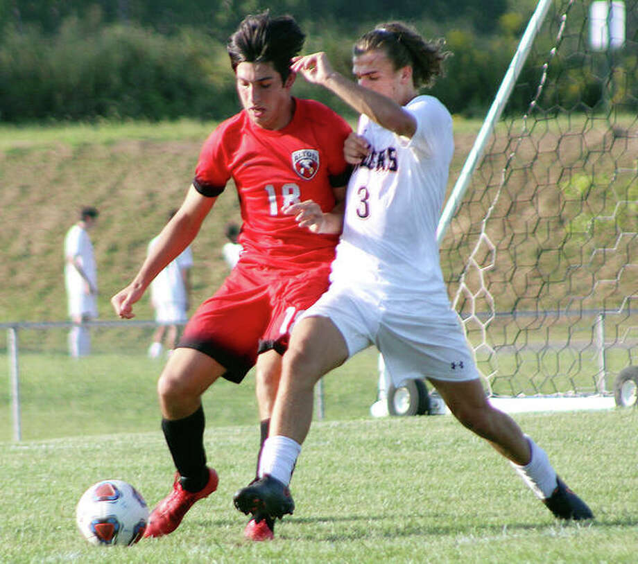 Edwardsville's Kadin Lieberman (3) and Alton's Justin Davison battle for the ball during Monday's game at Alton High School. Photo: Pete Hayes | The Intelligencer