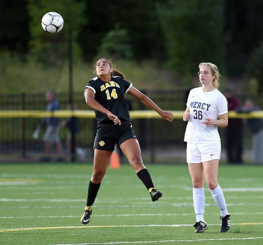 Kayla Howard, left, has been to the Class L state semifinals the last three season with the Hand girls soccer team. Photo: Arnold Gold / Hearst Connecticut Media / New Haven Register