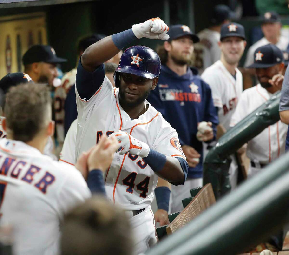 Houston Astros designated hitter Yordan Alvarez (44) celebrates his home run with George Springer during the sixth inning of an MLB baseball game at Minute Maid Park, Tuesday, Sept. 17, 2019, in Houston.