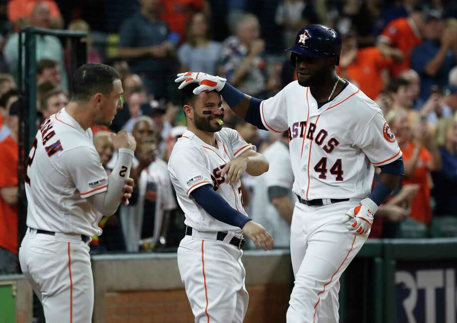 Houston Astros designated hitter Yordan Alvarez (44) celebrates his home run with Jose Altuve, and Alex Bregman during the sixth inning of an MLB baseball game at Minute Maid Park, Tuesday, Sept. 17, 2019, in Houston. Photo: Karen Warren, Staff Photographer / © 2019 Houston Chronicle
