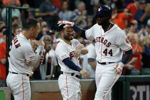 Houston Astros designated hitter Yordan Alvarez (44) celebrates his home run with Jose Altuve, and Alex Bregman during the sixth inning of an MLB baseball game at Minute Maid Park, Tuesday, Sept. 17, 2019, in Houston.