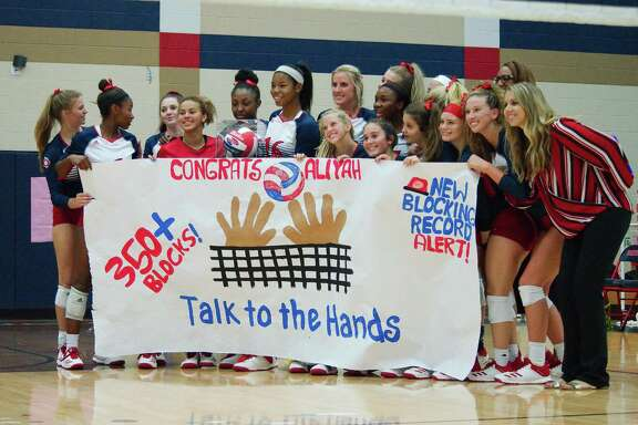 Dawson's Aliyah McDonald (16) is recognized for her school-record block total during the match against Pearland Tuesday at Dawson High School.