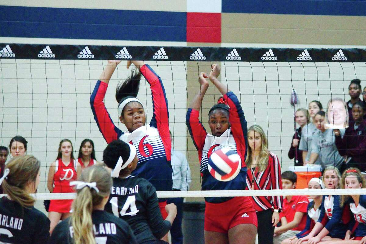 Dawson's Aliyah McDonald (16) and Alexia Jones (6), shown in action earlier this year, were key performers in the Lady Eagles' volleyball playoff win Monday in Pasadena.