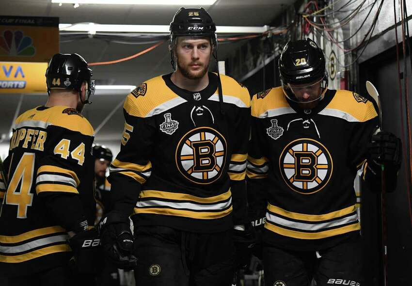 BOSTON, MA - MAY 26: Steven Kampfer #44, Brandon Carlo #25, and Joakim Nordstom #20 of the Boston Bruins in the tunnel prior to the start of the game against the St. Louis Blues in the Stanley Cup Final at the TD Garden on May 26, 2019 in Boston, Massachusetts. (Photo by Brian Babineau/NHLI via Getty Images)
