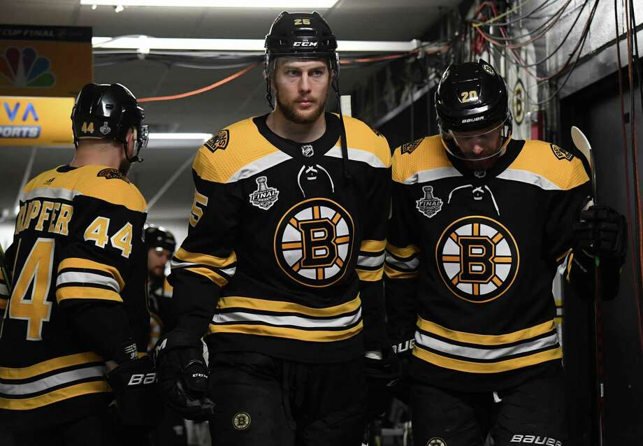 BOSTON, MA - MAY 26: Steven Kampfer #44, Brandon Carlo #25, and Joakim Nordstom #20 of the Boston Bruins in the tunnel prior to the start of the game against the St. Louis Blues in the Stanley Cup Final at the TD Garden on May 26, 2019 in Boston, Massachusetts. (Photo by Brian Babineau/NHLI via Getty Images) Photo: Brian Babineau / 2019 NHLI