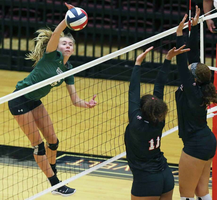 Alexis Durish hits for the Rattlers as Reagan beats Churchill 3-0 in volleyball at Littleton Gym on Nyah Anderson hits for the Rattlers Sept. 17, 2019. Photo: Tom Reel, Staff / Staff Photographer / 2019 SAN ANTONIO EXPRESS-NEWS
