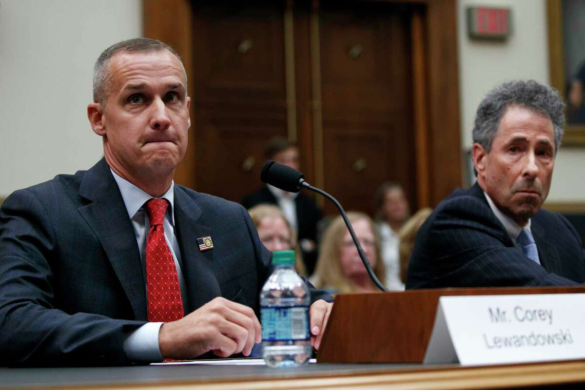 Attorney Peter Chavkin, right, takes a seat at the witness table with his client, Corey Lewandowski, the former campaign manager for President Donald Trump, in protest of Lewandowski's questioning by a Majority staffer during a House Judiciary Committee hearing, Tuesday, Sept. 17, 2019, on Capitol Hill in Washington. (AP Photo/Jacquelyn Martin)