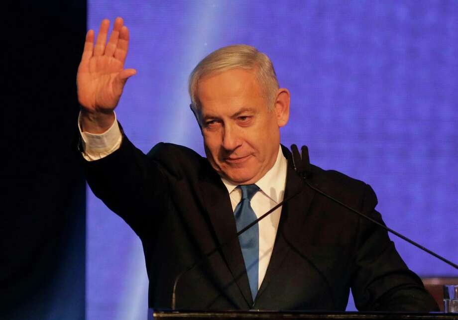 """Israeli Prime Minister Benjamin Netanyahu waves as he addresses supporters at his Likud party's electoral campaign headquarters early on September 18, 2019. - Israeli Prime Minister Benjamin Netanyahu said he was waiting for results in the country's general election, but that he was prepared for negotiations to form a """"strong Zionist government."""" He spoke as exit polls showed a tight race between his right-wing Likud and ex-military chief Benny Gantz's centrist Blue and White alliance. (Photo by Menahem KAHANA / AFP)MENAHEM KAHANA/AFP/Getty Images Photo: MENAHEM KAHANA / AFP or licensors"""
