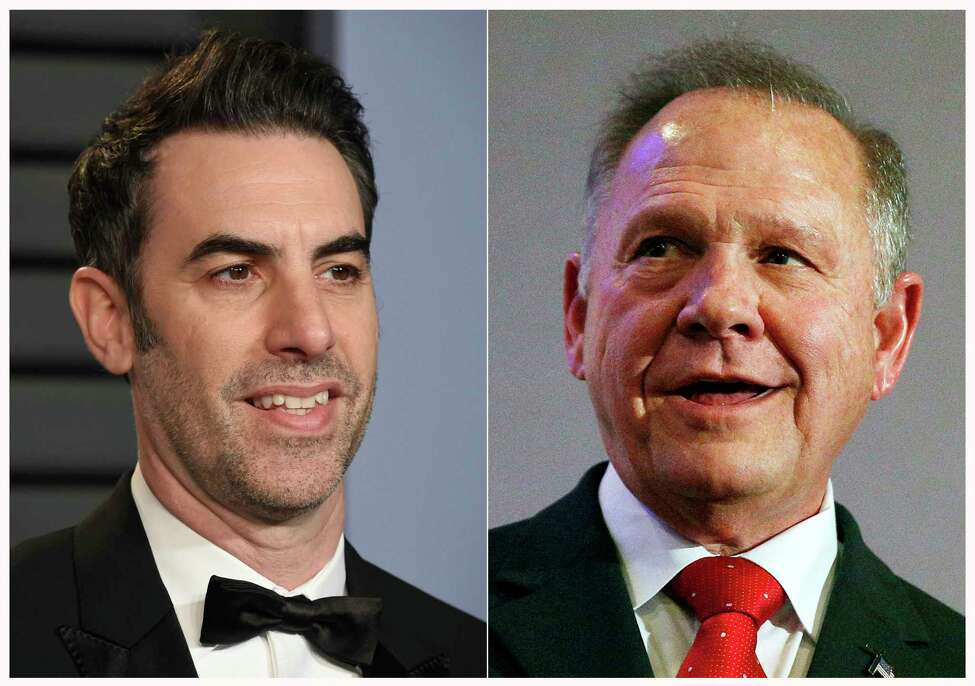 This combination of photos shows actor-comedian Sacha Baron Cohen at the Vanity Fair Oscar Party in Beverly Hills, Calif. on March 4, 2018, left, and former Alabama Chief Justice and then U.S. Senate candidate Roy Moore at a news conference in Birmingham, Ala., on Nov. 16, 2017. Cohen is asking a federal judge to dismiss Roy Moorea€™s defamation lawsuit over a 2018 television segment of