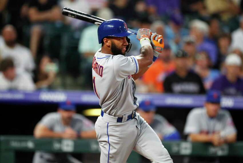 New York Mets' Amed Rosario singles off Colorado Rockies starting pitcher Tim Melville during the third inning of a baseball game Tuesday, Sept. 17, 2019, in Denver. (AP Photo/David Zalubowski)