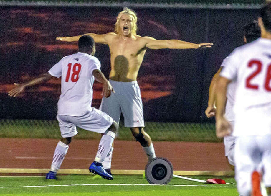 SIUE's Jorge Gonzalez, after ripping off his jersey, celebrates with teammate Vincent Jackson II (18) Tuesday night after scoring the game-winning overtime goal in the Cougars 2-1 win over Butler at Korte Stadium. Photo: Scott Kane, SIUE | For The Telegraph