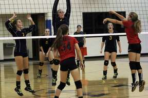 The North Huron Warriors and the Owen-Gage Bulldogs battled it out on the volleyball court on Tuesday night. The Warriors won in straight sets, 25-10, 25-22 and 25-15.