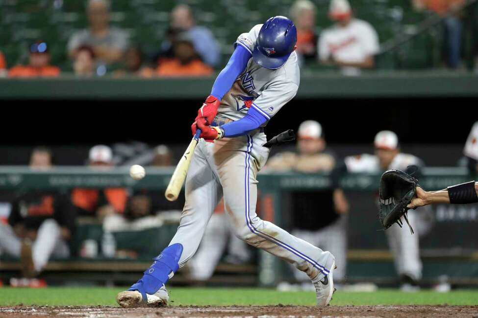 Toronto Blue Jays' Cavan Biggio hits a double off Baltimore Orioles pitcher Shawn Armstrong during the eighth inning of a baseball game Tuesday, Sept. 17, 2019, in Baltimore. The Blue Jays won 8-5. (AP Photo/Julio Cortez)