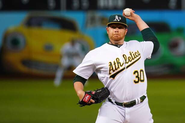 OAKLAND, CALIFORNIA - SEPTEMBER 17: Brett Anderson #30 of the Oakland Athletics pitches during the first inning against the Kansas City Royals at Ring Central Coliseum on September 17, 2019 in Oakland, California. (Photo by Daniel Shirey/Getty Images)
