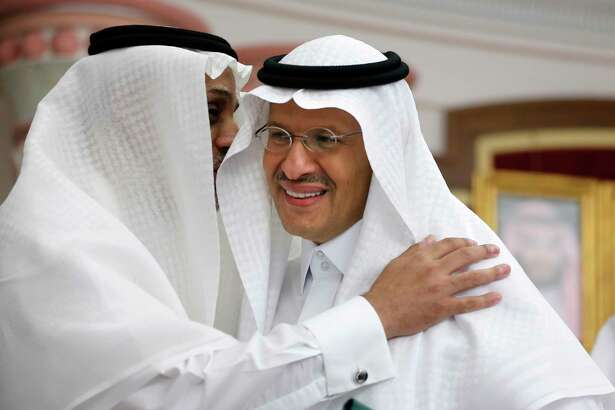 Energy Minister Prince Abdulaziz bin Salman smiles as he is congratulated after a press conference in Jiddah, Saudi Arabia, Tuesday, Sept. 17, 2019. Saudi Arabia's energy minister said Tuesday that 50% of its daily crude oil production that was knocked out by a weekend attack had been restored and that full production is expected by the end of the month.