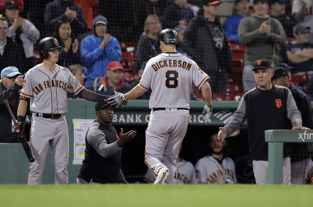 San Francisco Giants' Alex Dickerson (8) is congratulated after his sacrifice fly drove in a run in the 15th inning of the team's baseball game against the Boston Red Sox at Fenway Park in Boston, early Wednesday, Sept. 18, 2019. (AP Photo/Charles Krupa)