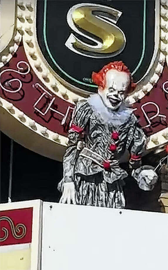 """Photo: An Animatronic Pennywise Stood On The Marquee Of The Illinois Theater In Downtown Jacksonville Until This Weekend, When Someone Swiped The Evil Clown. Pennywise Is The Star Of The """"It"""" Series Of Horror Films And Was Being Displayed Because The Theater Is Showing """"It Chapter 2."""" Illinois Theater 