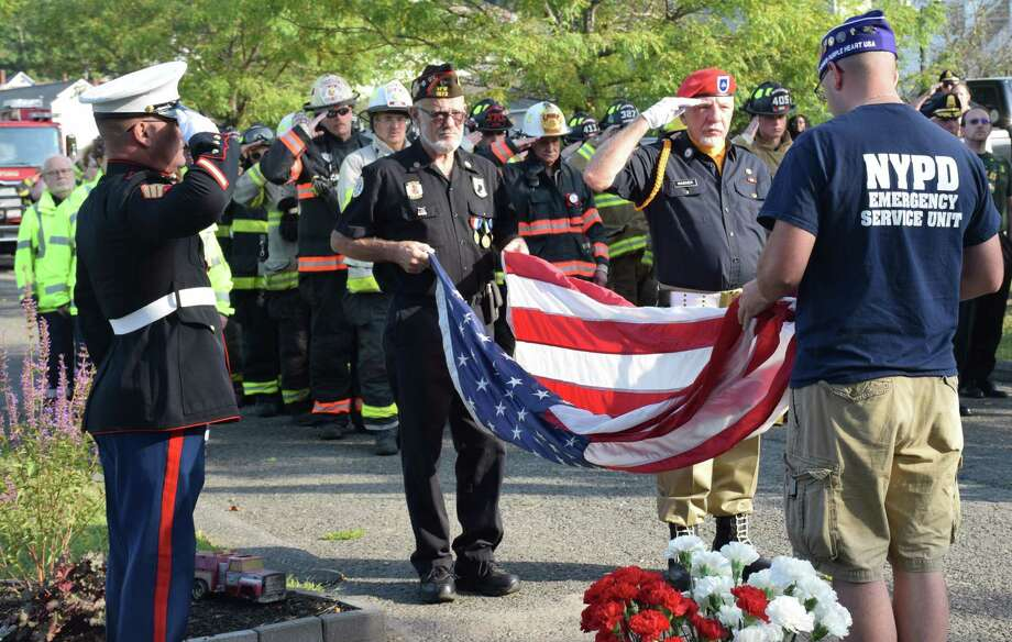 The town of New Milford will mark the 19th anniversary of 9/11 with a Sept. 11 ceremony. Above is a photograph from the 2019 morning ceremony. Photo: Deborah Rose / Hearst Connecticut Media / The News-Times  / Spectrum