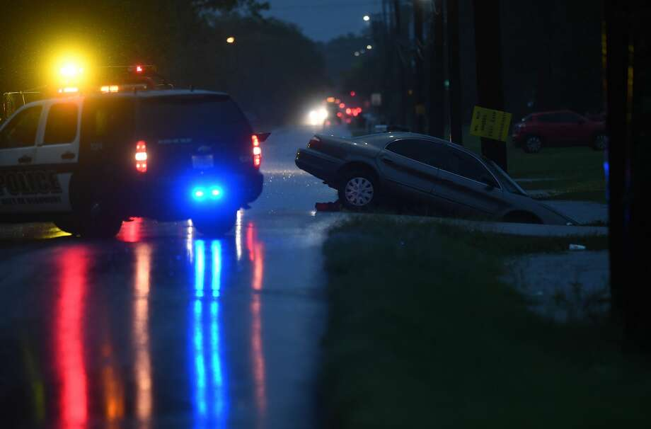 A tow truck lines up to remove a car from a flooded ditch in Beaumont's west end early Wednesday morning.  Photo taken Wednesday, 9/18/19 Photo: Guiseppe Barranco/The Enterprise