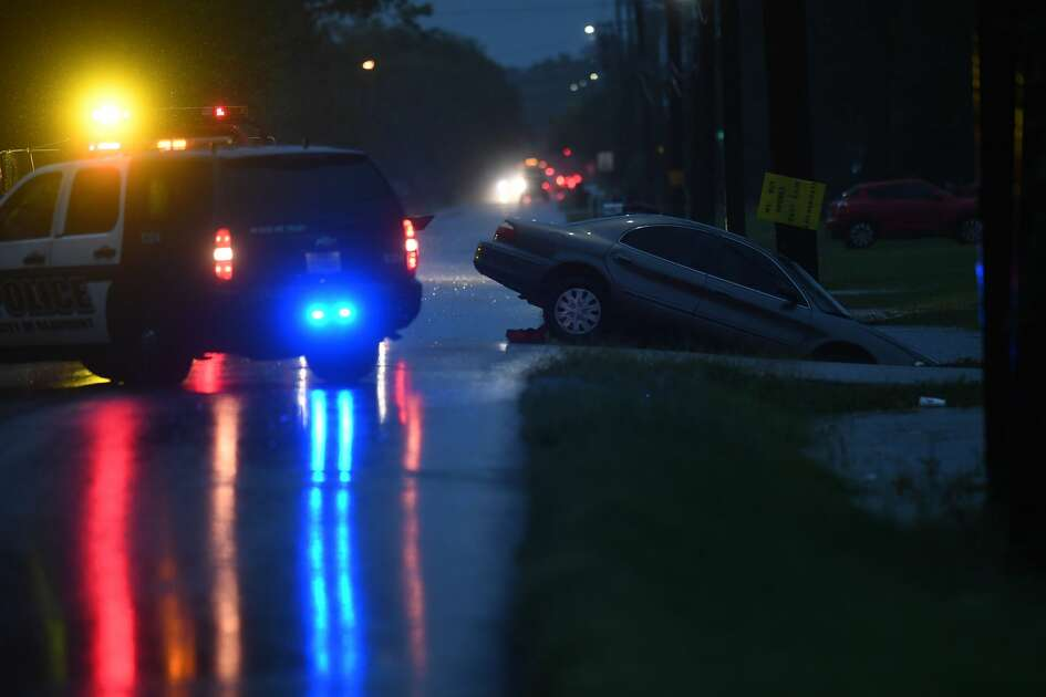 A tow truck lines up to remove a car from a flooded ditch in Beaumont's west end early Wednesday morning. Photo taken Wednesday, 9/18/19