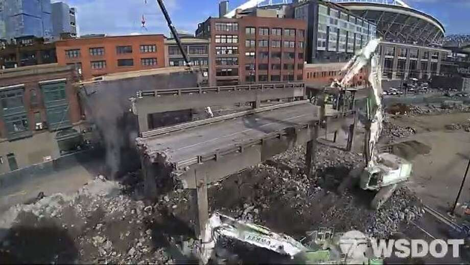 A screenshot from a time-lapse video shows crews removing one of the final pieces of the Alaskan Way Viaduct near the stadiums. Work finished in just six days. Watch the full time-lapse video below. Keep clicking to see photos of the viaduct's demolition. Photo: Courtesy WSDOT