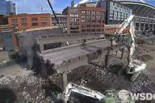 A screenshot from a time-lapse video shows crews removing one of the final pieces of the Alaskan Way Viaduct near the stadiums. Work finished in just six days. Watch the full time-lapse video below. Keep clicking to see photos of the viaduct's demolition.