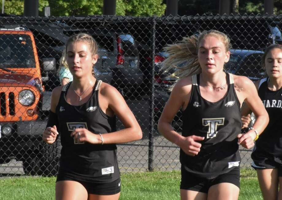 Trumbull seniors Alessandra Zaffina and Emily Alexandru led the Eagles to an FCIAC quad-meet sweep on Tuesday. Photo: Contributed Photo / Trumbull High Athletics / Trumbull Times